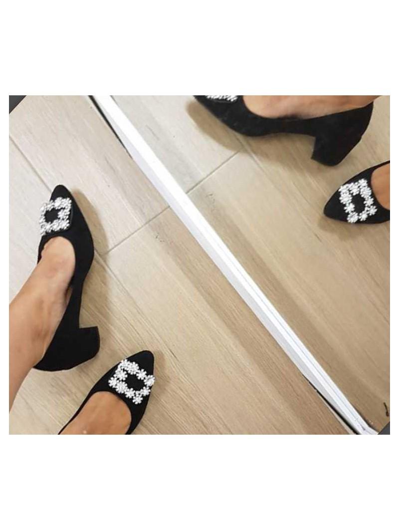 Zapatos negros hebilla central
