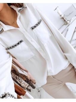 Blusa blanca bolsillos y...