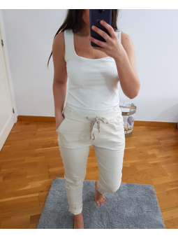 Pantalón beige elástico...