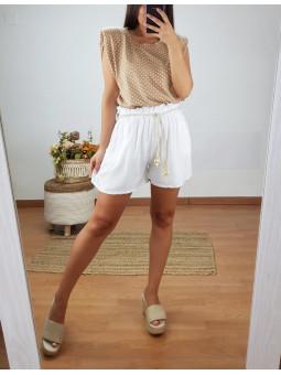 Pantalón blanco corto...