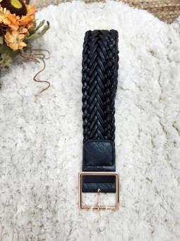 Cinturón negro trenzado...