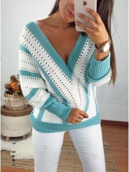 Suéter franjas turquesa y...