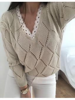 Suéter beige troquelado...