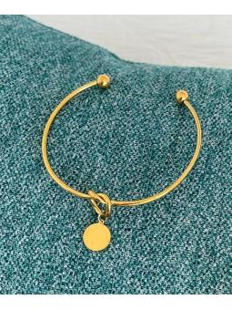 Pulsera rígida dorada círculo